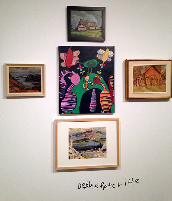 Collection of paintings on gallery wall