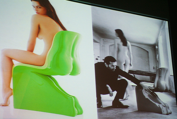 Italian designer Fabio Novembre speaking at IDS in front of a double image of himself on the screen