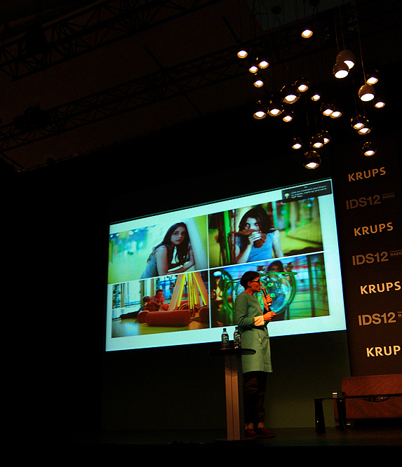 Designer Matali Crasset speaking at IDS on stage in front of screen