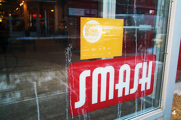 Sign of Smash and Toronto Design Offsite on the glass window front of the store