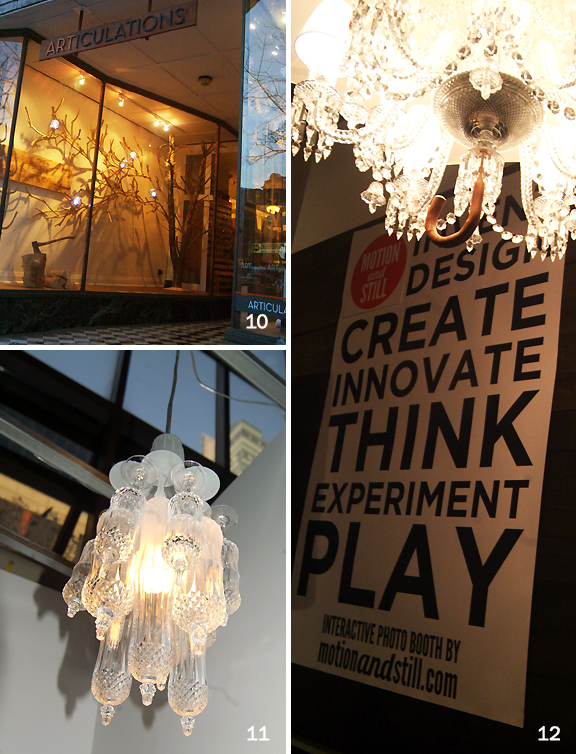 Window display with wooden lamp, chandilier with umbrella handle, and chandilier made with recycled stemware