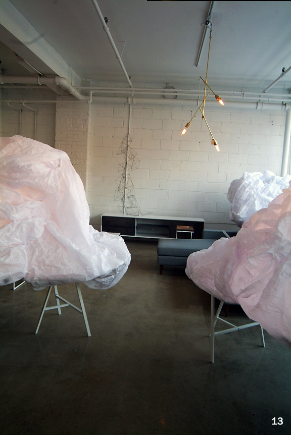 White paper cloud like structures around modern furniture