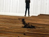 Person looking at Ai Weiwei exhibits